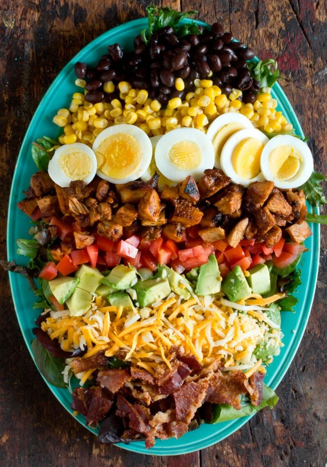 Cobb salads are a weekly occurrence at my house. They are filling, fast, and can be modified to suit any preferences, plus they are a great way to use up leftovers. This version is loaded with zesty barbecue chicken, black beans, and cheddar jack cheese for a Southwestern spin on the American classic.