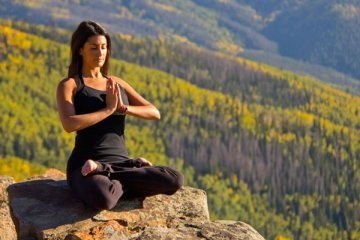Yoga on top of a mountain after a wondrous climb, Bucket List.