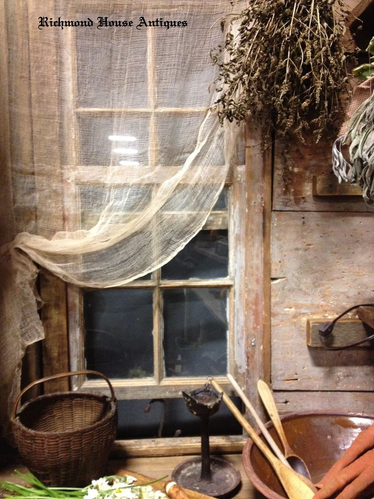 Prim...cheesecloth curtains at the window.  Love this idea for the front enclosed porch....yep, dark plum paint and prim cheesecloth curtains....  Thanks for this idea...potting shed curtains!