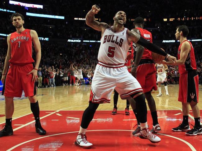 Carlos Boozer exulte après la victoire de Chicago sur les Toronto Raptors (102-101 ap). Les Bulls ont composté leur billet pour les Play-offs