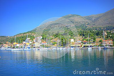 Scenic view of Agia Efimia or Aghia Effimia-pretty fishing village and harbour, seen from the serene blue water of Ionian Sea,Kefalonia island,Greece