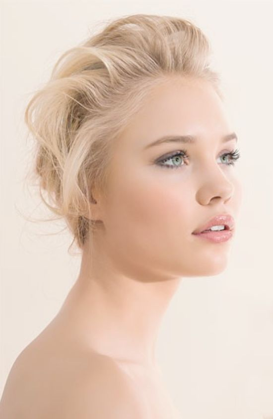 Fair skin, blond hair, blue eyes, natural, peachy blush wedding make-up.