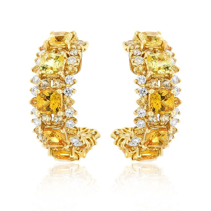 Escape the ordinary with this pair of Cirque yellow sapphire and diamond open hoop earrings for pierced ears. Crafted in 18ct yellow gold. Length 17mm. Width 5mm. #Cirque #Earrings #YellowSapphire #GerardMcCabe