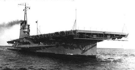 USS Wolverine (IX-64) and commissioned in August of 1942, the vessel, which lacked the hangar decks and defensive weaponry of a conventional aircraft carrier, would be little more than a floating runway. Yet despite her shortcomings, the Wolverine was a handy platform for pilots to practice take offs and landing, thus freeing up frontline carriers for combat duty. By early 1943, the vessel was sailing daily from Chicago's Navy Pier into Lake Michigan where she'd conduct flight training…
