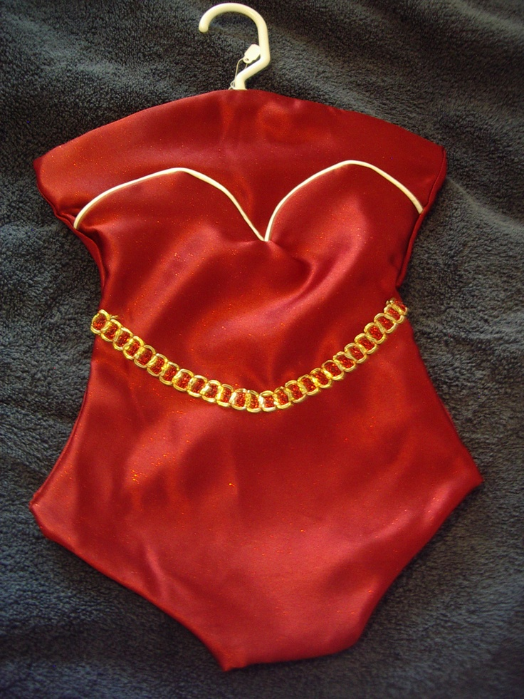 Red Satin trimmed in white and gold. This is a Lingerie Keeper I made.  It opens along the bustline to a full length pocket. This could also be used as a Santa Stocking for hiding Christmas goodies.