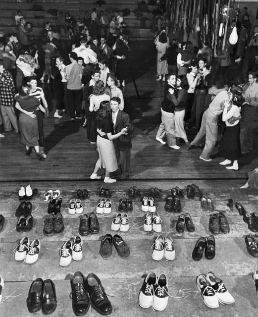 Sock hops were popular among teenagers in the 1950s. Dancers were told to remove their shoes to protect the floor of the high school gymnasium, where disc jockeys played music from vinyl records. Sock hops are associated with rock n roll music, which was also popular during the 1950s.