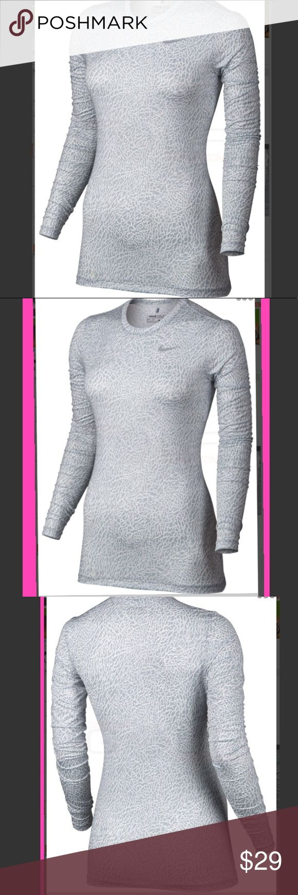 Nike golf shirt Nike Printed Crew Golf Baselayer is made with lightweight fabric powered by sweat-wicking Dri-Fit technology to help you stay dry and comfortable. Crew-neck design provides a nonrestrictive fit. Lightweight jersey fabric stretches with your body as you move. Provides UVA and UVB protection from the sun in the areas covered by the garment. 88% polyester/12% spandex. Brand new with tags! Nike Tops