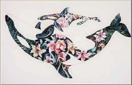 Mother and Baby Orca    Leis, corsages, and bouquets are ways we honor each other. The bodies of these whales are adorned with flowers which is my way of honoring their sacredness.      Evokes:  Love of Nature, Beauty and Joy