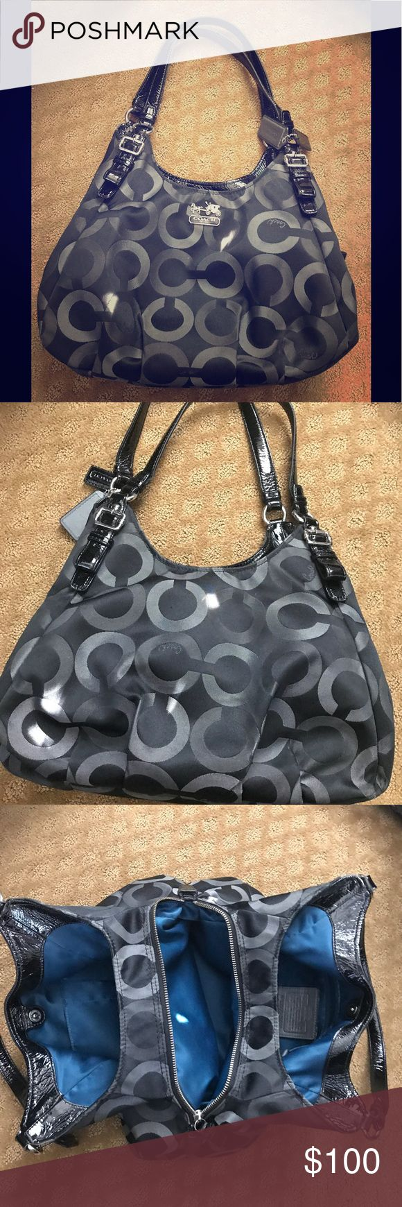 Black Coach purse handbag Beautiful coach purse, that is in great condition. Has a really clean inside and no cracking in handles. Does have the attached Coach tag but no dust bag included. The inside color is beautiful! The back of the bag is a little dirty but nothing too noticeable. Coach Bags Shoulder Bags