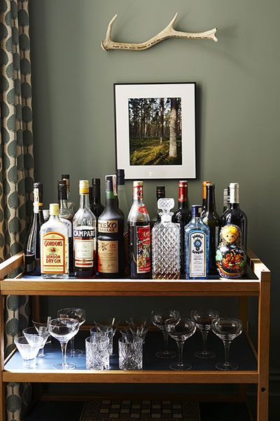 Credit: Rachel Whiting Above a mid-century drinks trolley from themodernwarehouse.com is a w...