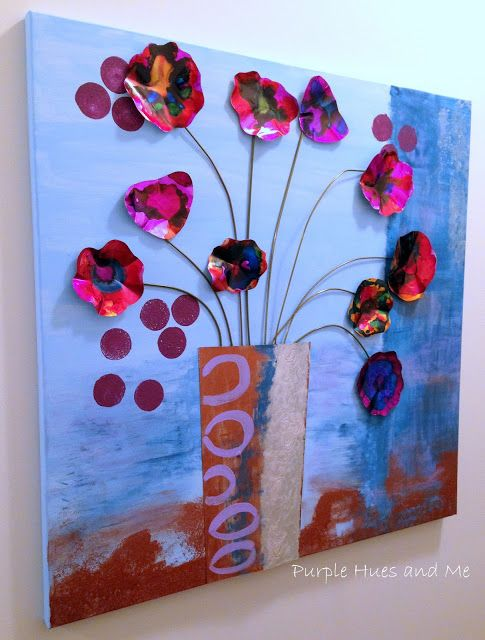 http://plumperfectandme.blogspot.com/2015/06/upcycled-soda-can-flowers-wall-art.html