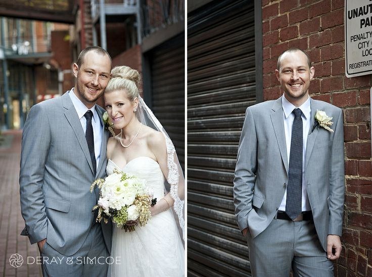 Urban bride and groom. Groom wears a blue / grey suit and bride wears Vera Wang hairstyle with a lace trim veil