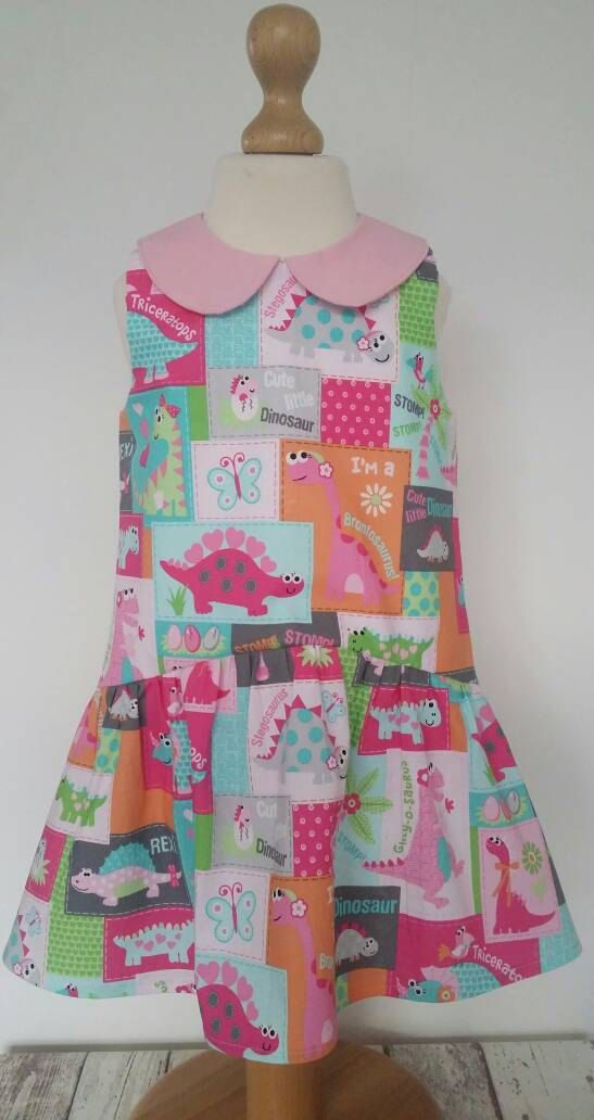 Check out this item in my Etsy shop https://www.etsy.com/uk/listing/504590325/dinosaur-dress-peter-pan-collar-dinosaur