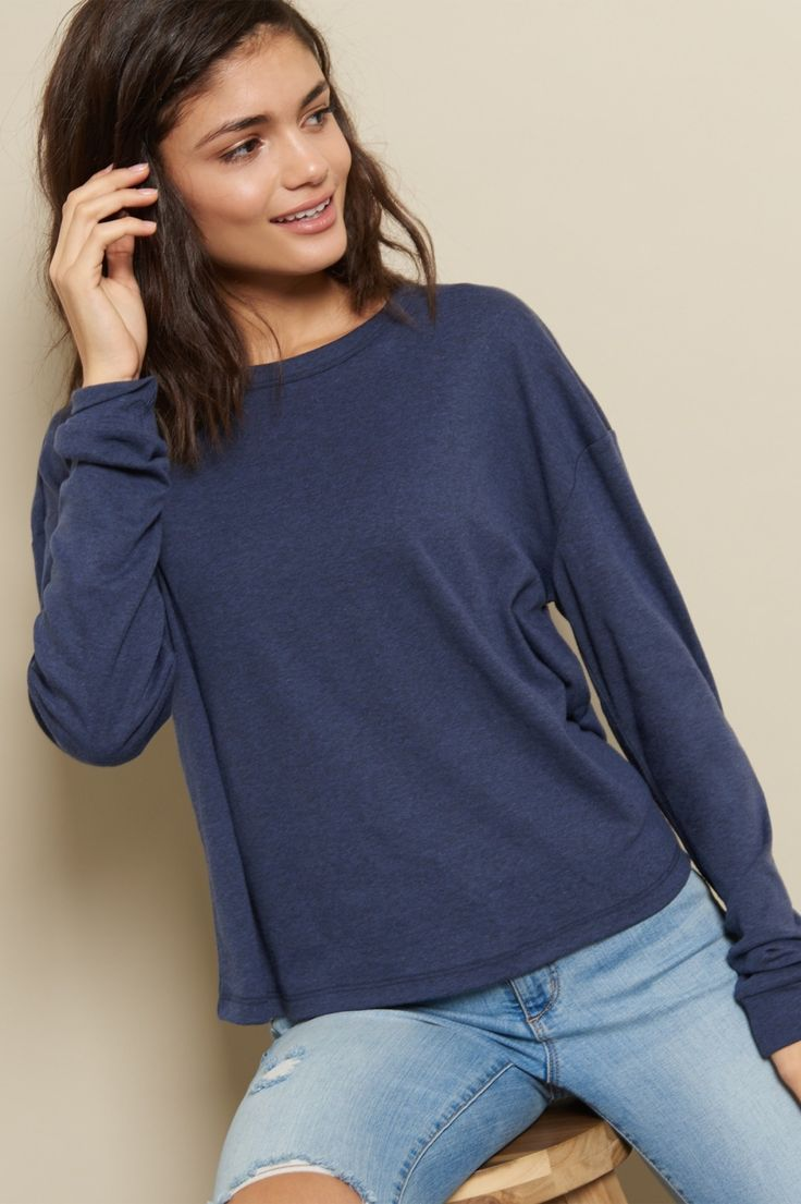 Throw on a cozy essential! Lightweight and soft, this crewneck tee is perfect for putting a quick look together.