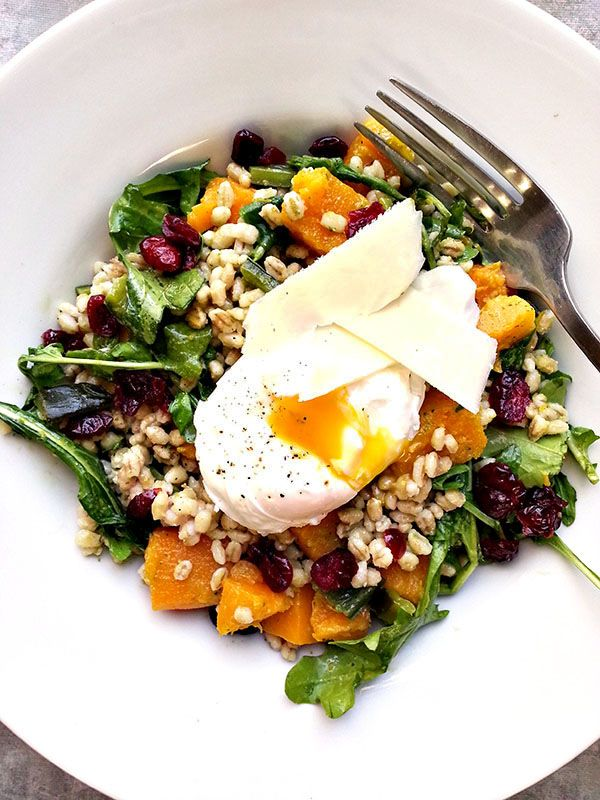 Roasted butternut squash and barley salad with dried cranberries, arugula and a poached egg.