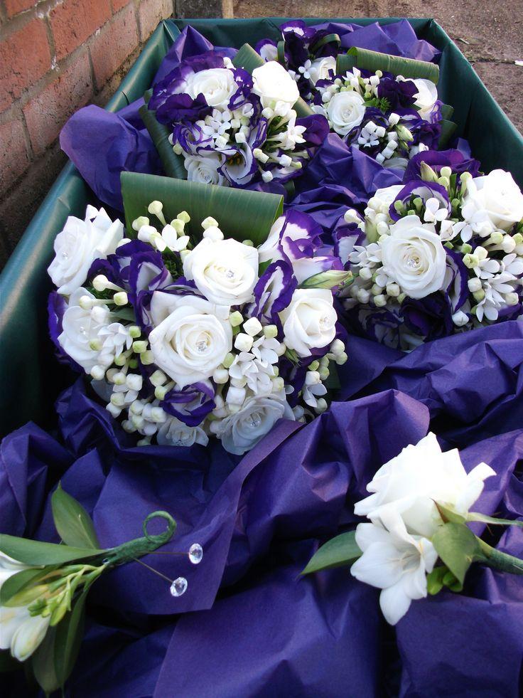 Bridemaids bouquets featuring, white lisianthus, purple edged lisianthus, white bouvardia and aspidistra leaves