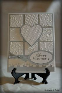 handmade anniversary card ... Created By Rosie ... various embossing folder textures on inchies in 3 X 3 grid ... heart popped up on top ... silver and white ...