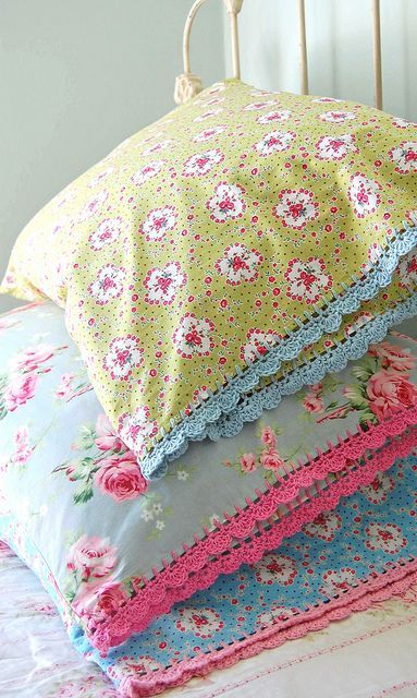 Love these...Use a sharp crochet hook to single crochet around the perimeter or use a darning needle to sew blanket stitch around for base to work edging into.: