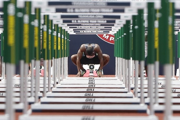 David Oliver prepares to start in the men's 110 meter hurdles qualifying round at the U.S. Olympic Track and Field Trials on Friday, June 29, 2012 in Eugene, Ore.