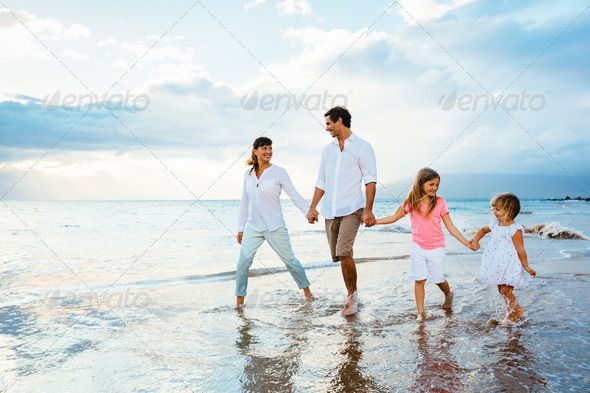 Happy young family walking on the beach by EpicStockMedia ...