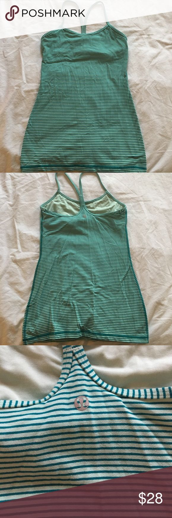 Striped Lululemon racerback tank w/ built in bra Striped Lululemon racerback tank w/ built in bra, form fitting and like new. Dark green and light green thin striped. lululemon athletica Tops Tank Tops