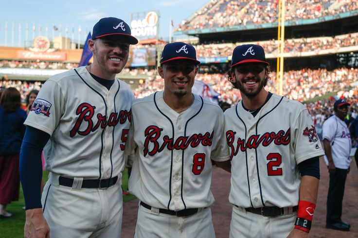 October 2, 2016; Atlanta, GA, USA; Atlanta Braves first baseman Freddie Freeman (5) and second baseman Jace Peterson (8) and shortstop Dansby Swanson (2) pose for a photo after a game against the Detroit Tigers at Turner Field. The Braves defeated the Tigers 1-0. Mandatory Credit: Brett Davis-USA TODAY Sports