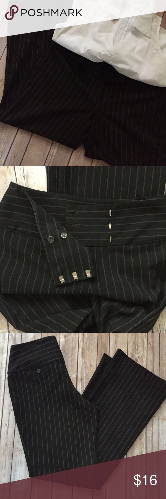 """INC Black and Pink Pinstriped Pants Sz 8 If pinstripes were ever sexy, it was on these pants! A nice heavyweight Poly/Rayon/Spandex blend perfect for Fall🍁 Lightly worn & in great used condition w/ no flaws. They feature an extra wide waistband (shown Pic 2) that really makes these fit amazing. They do flare and look great with heels or boots. Waist 16"""" flat. Rise 10"""". Inseam 33"""". Very well made! Please feel free to ask me any questions or make me an offer. Thanks for checking out my closet…"""