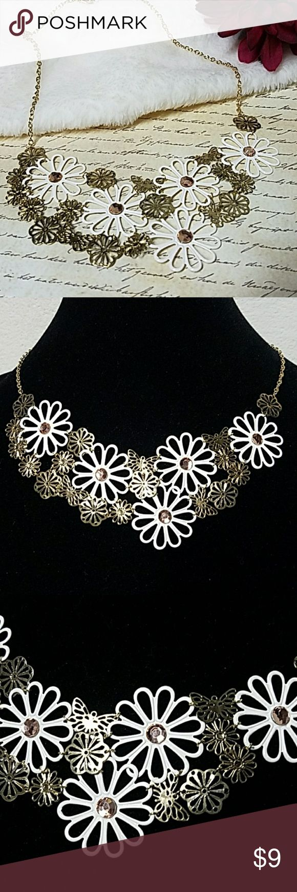 """Gold & White Flower Cluster Collar Necklace Fun & trendy necklace for the spring & summer! About 15"""" Long. Butterflies throughout. Lobster clasp closure. Item#N972 *ALL JEWELRY IS NWT/NWOT/UNUSED VINTAGE* 25% OFF BUNDLES OF 3 OR MORE ITEMS! **ALL REASONABLE OFFERS ACCEPTED** BUY WITH CONFIDENCE~TOP 10% SELLER, FAST SHIPPING,5 STAR RATING, FREE GIFT w/MOST ORDERS! Jesi's Fashionz  Jewelry Necklaces"""