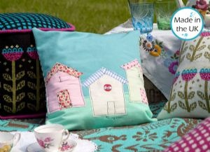 Beach Huts cushion by Poppy Treffry