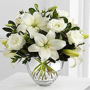 The FTD® White Elegance™ Bouquet by Vera Wang http://www.enchantedfloristcanada.com/product/the_ftd_white_elegance_bouquet_by_vera_wang/display