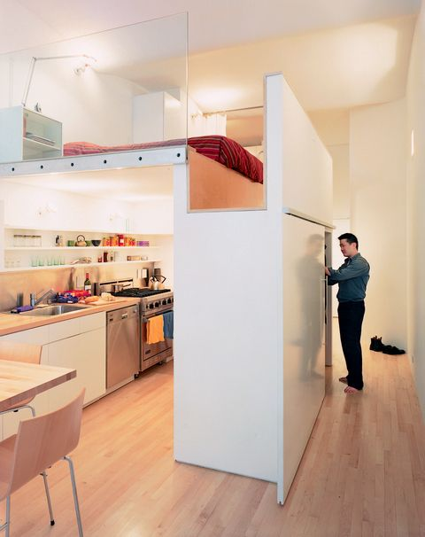 """""""Wonbo had to be able to stand in the sleeping area,"""" architect Kyu Sung Woo says of his son. """"By combining two dimensions—the height of the bed and that of the closet (the top of which forms the bedroom floor)—we made that possible.""""  Photo by: Adam Friedberg      Read more: http://www.dwell.com/slideshows/big-city-little-loft.html?slide=1=y=true#ixzz27WYq4cHW"""
