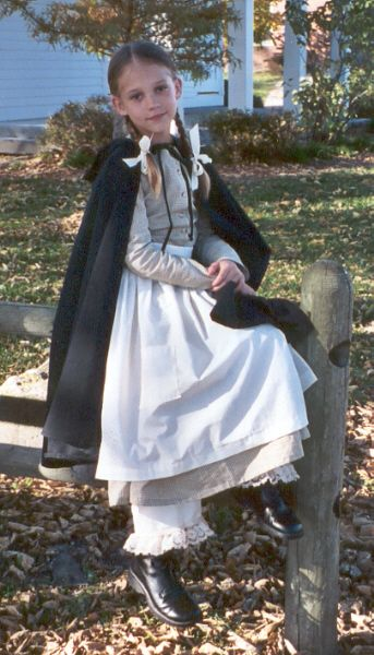 pioneer woman clothing 1800. in childrens pioneer clothing, the daisy dress is shown and buttons down front. woman clothing 1800