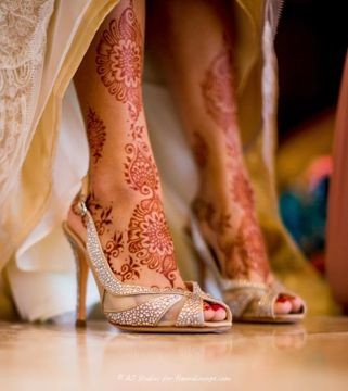 Indian bridal heels and leg mehendi or henna.