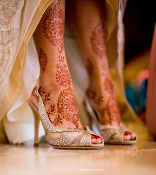 Indian bridal heels and leg mehendi or henna.