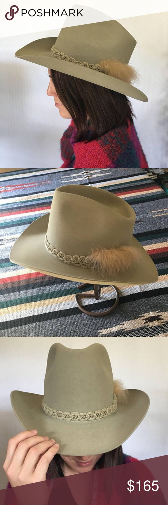 Vintage Resistol Cowboy Hat w/ Feathered Hat Band This great vintage Resistol Cowboy Hat is marked as 7 1/8 size and comes with original Resistol Hatbox.  Tan/khaki beaver hat (photos not filtered, color appears different in natural and interior lighting).  Hat band includes emu feather. It is in good vintage condition with two faint marks and 1 small divit in less noticeable areas. The body of the hat is taller which flatters a smaller statured person and adds appearance of height. The…