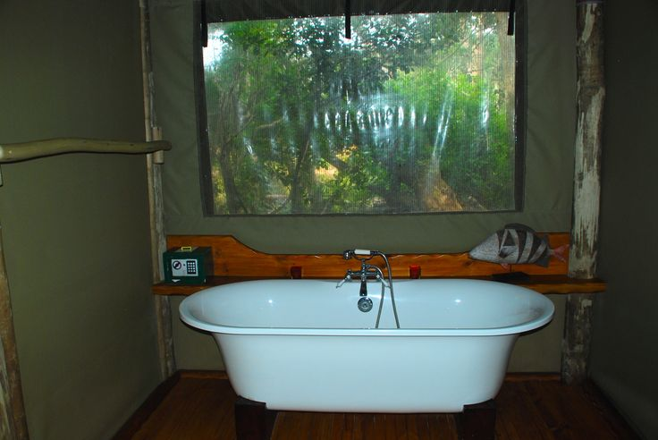 Beautiful relaxing bath in Tent 1 overlooking the bush and river at River Camp at Sibuya Game Reserve in the Eastern Cape of South Africa www.sibuya.co.za