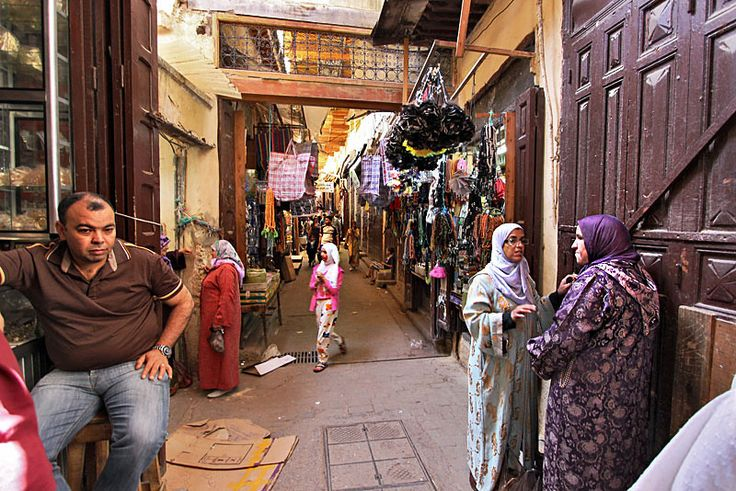Local women share shopping and gossip in the Medina (old city) in Fez, Morocco