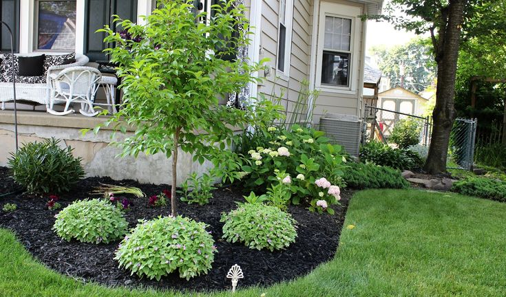 pictures of flower beds in front of house | Can you see the pink hydrangea on the side of the porch?