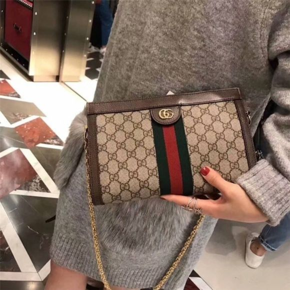 f40687039 Gucci Ophidia GG small shoulder bag Crafted in GG Supreme canvas with  inlaid Web stripe detail