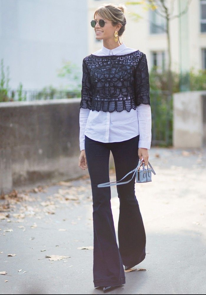 Intricate sheer crop top over white dress shirt and flared trousers