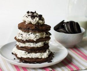 "Double Stuff Oreo Pancakes are a cookie lovers dream breakfast. Chocolate pancakes ""stuffed"" with a thick oreo whipped cream."