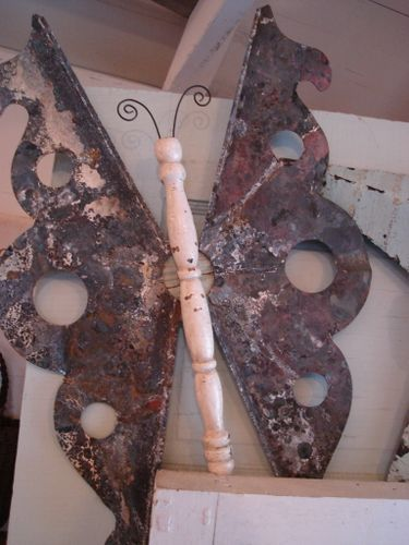 Junkyard butterfly. Salvaged metal pieces and a cast off chair spindle. One mans junk...........
