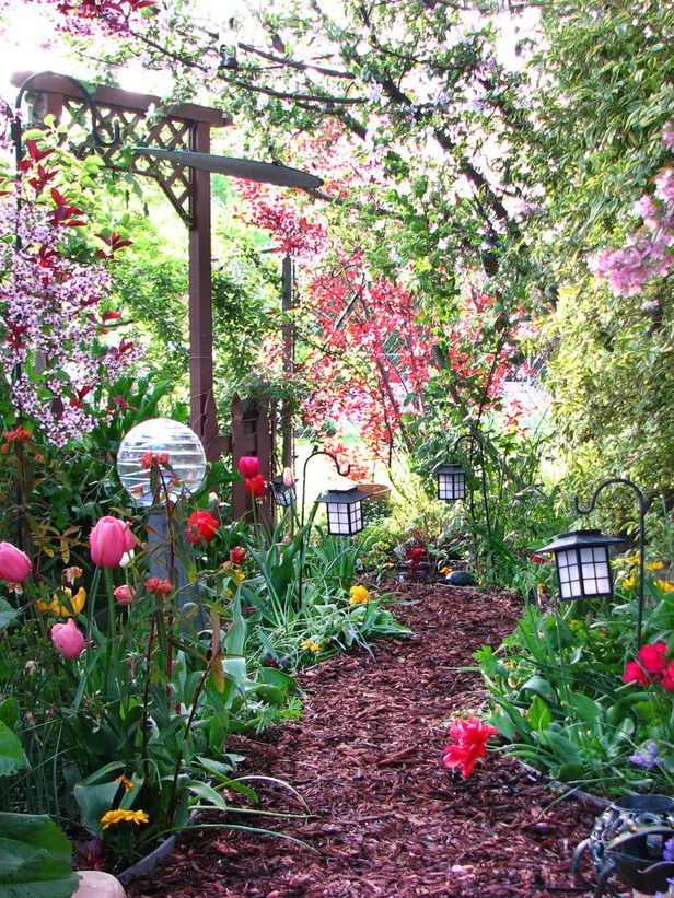 Mulch and colorful creativity combine in this charming garden path.