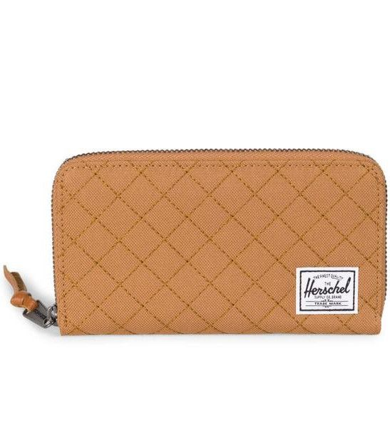 A caramel colored, clutch-style silhouette with custom diamond stitching and gunmetal hardware, the functional Quilted Thomas wallet features ample storage for cards, currency and a mobile phone. Quil