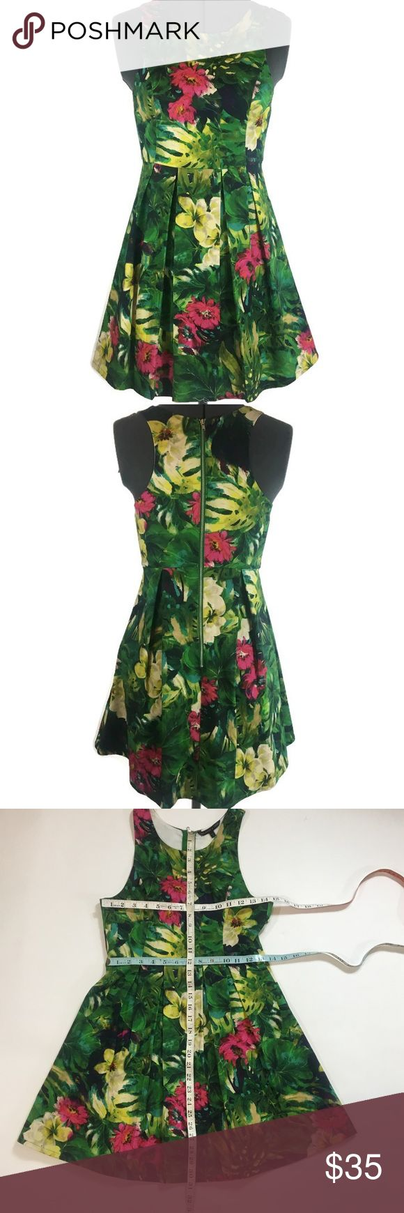 """Felicity & Coco- Tropical Print Dress Felicity & Coco- dress with bodice princess style lines, skirt pleats, and center back exposed zipper. Tropical palm/floral print. Approximate measurements and care instructions in photos. Small """"x"""" marked in sharpie under tag (please see photo). Felicity & Coco Dresses"""