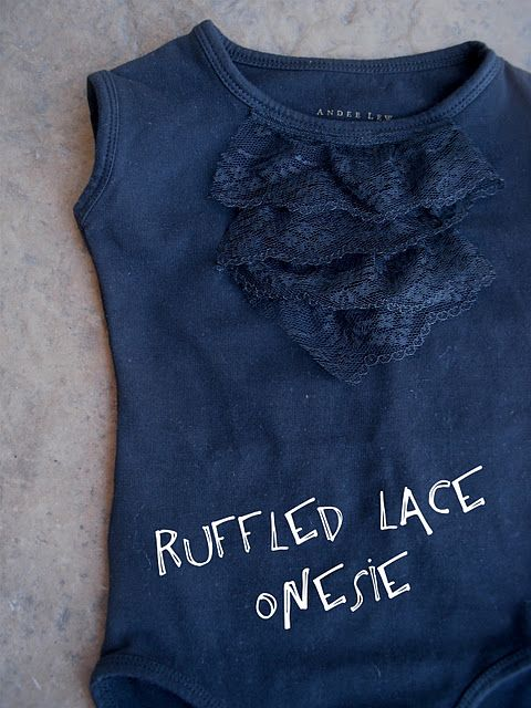 Ruffled lace on a onesie.....I'm thinking it would be a cute addition to a few of the girls shirts!