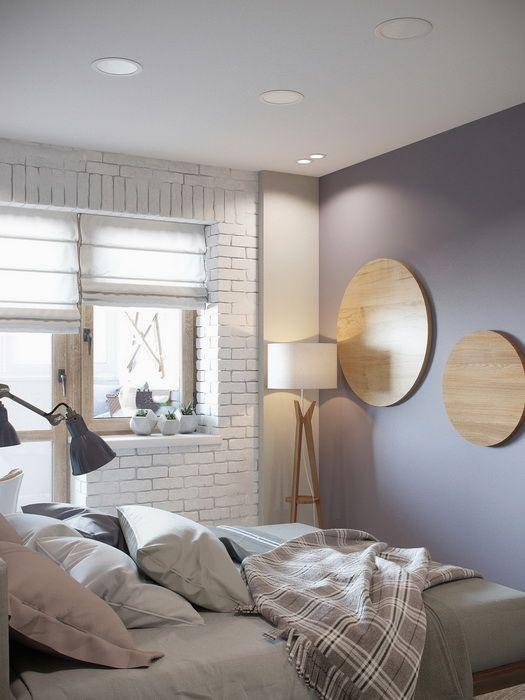 Chambre scandinave avec un mur gris