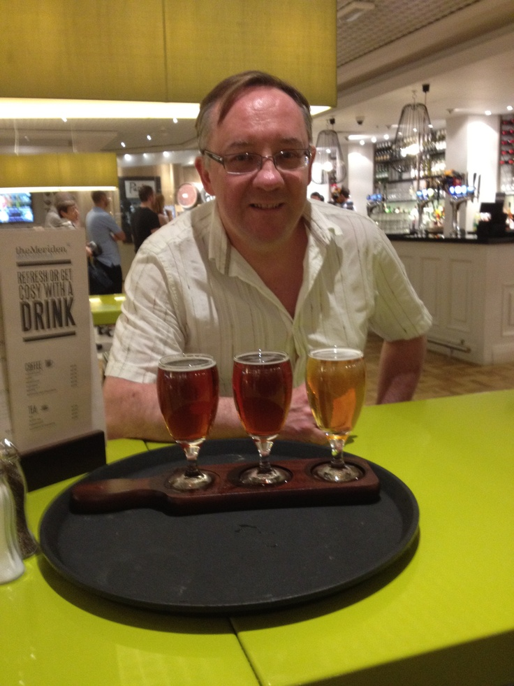 Ian drinking 3 beers, one of which was Purity Gold, at the Meriden Bar, Birmingham Airport