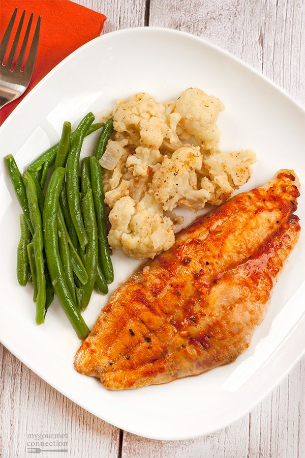 Flavored with a mixture of melted butter, tomato and a spicy, Creole seasoning blend, these baked catfish fillets make a quick and easy dinner.
