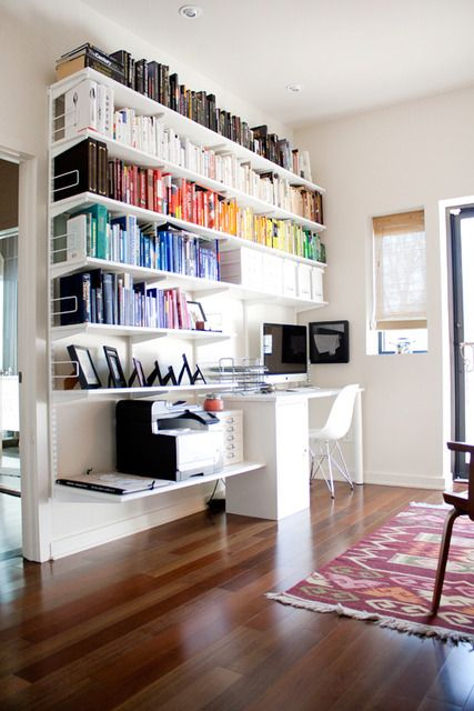 "Wow!  What a home office!  An elfa desk with Bisley file cabinet on the left and legs on the right provides a beautiful foundation for this space.  elfa solid white 12"" shelves keep books and photos looking great while a 16"" shelf provides the right platform for a printer and small Bisley drawer unit."
